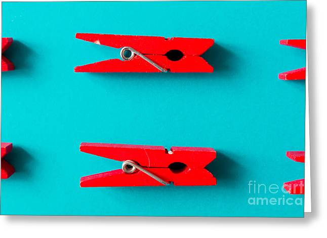 Red Clothespins On Cyan Background Greeting Card by Zamurovic Photography
