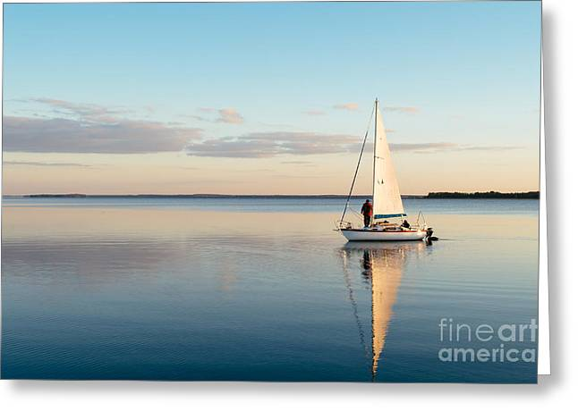 Sailing Boat On A Calm Lake With Greeting Card
