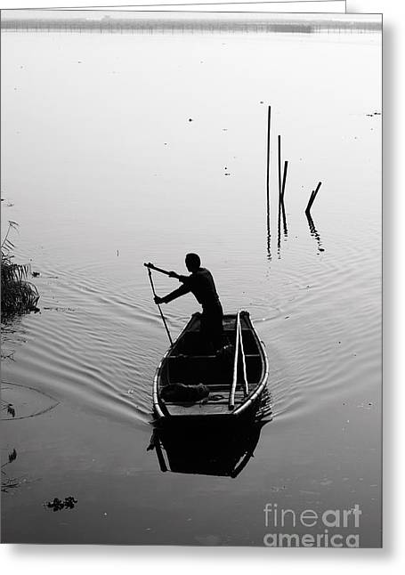 Silhouette Of A Boatman Rowing A Greeting Card