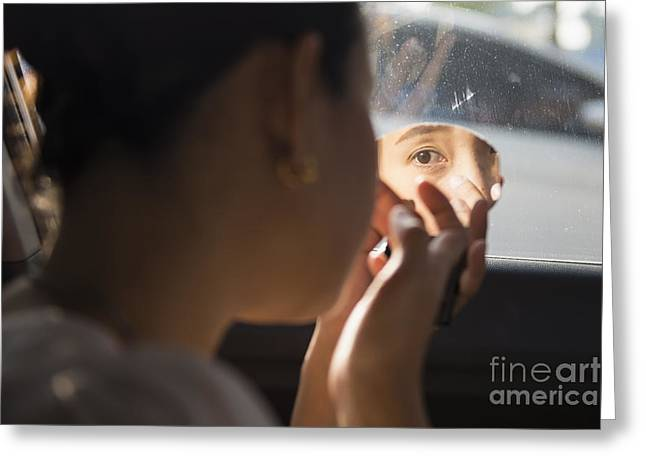 The Girl Is Doing Makeup In The Car Greeting Card by Nattapan72