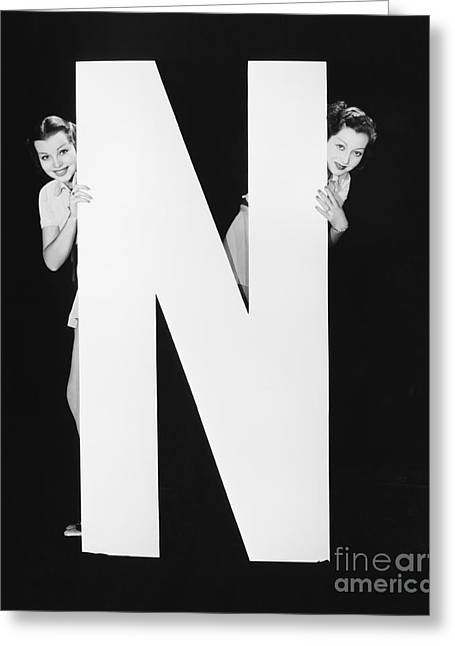 Two Women Hiding Behind Huge Letter N Greeting Card