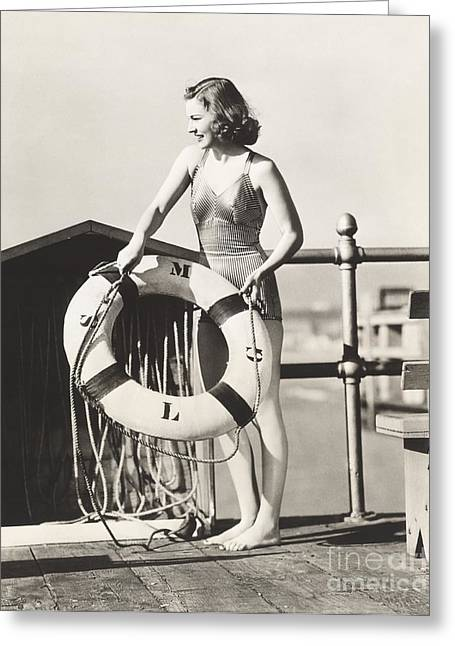 Woman On Pier Holding A Life Preserver Greeting Card