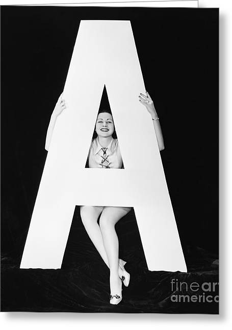 Woman With Huge Letter A Greeting Card by Everett Collection