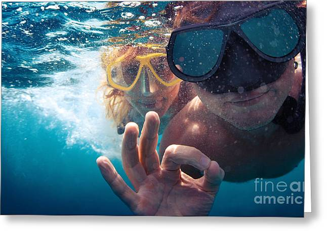 Young Couple Having Fun Underwater And Greeting Card