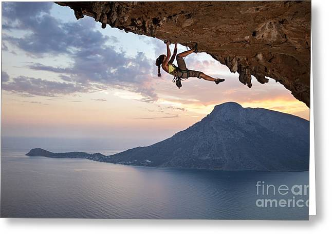 Young Female Rock Climber At Sunset Greeting Card