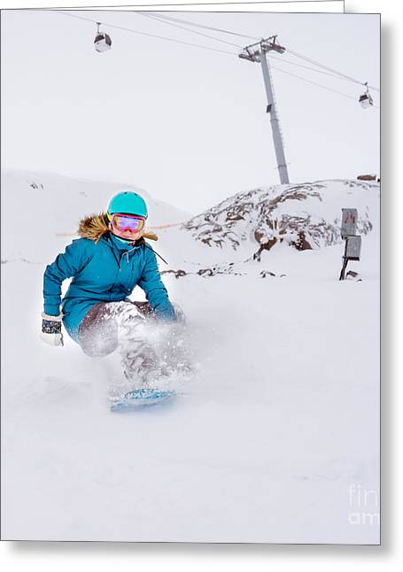Young Woman Snowboarder In Motion On Greeting Card