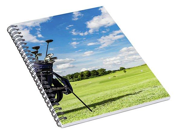 Golf Equipment Bag Standing On A Course. Spiral Notebook