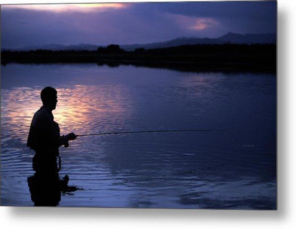 A Man Fly Fishing At Sunset Metal Print