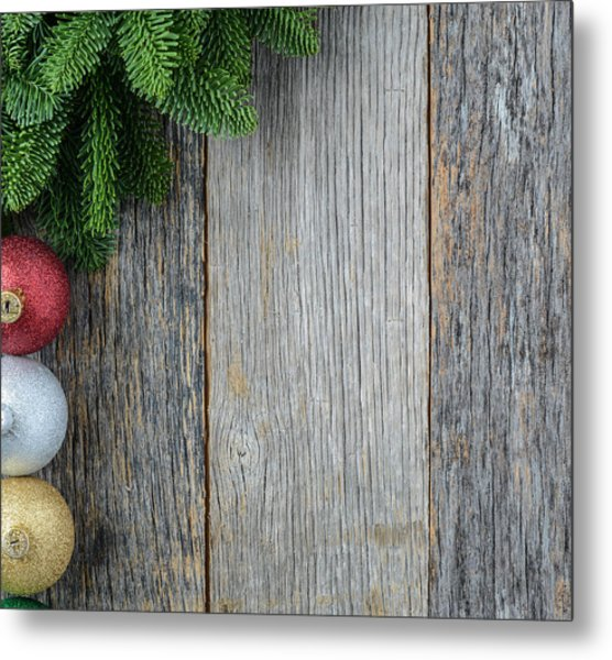 Christmas Pine Needle And Ornaments On A Rustic Wood Background Metal Print