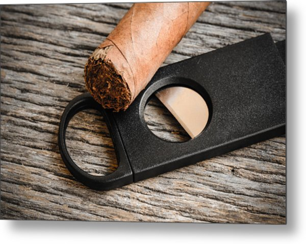 Cigar And Cigar Cutter On Rustic Wood Background Metal Print