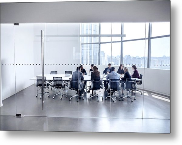 Colleagues At Business Meeting In Conference Room Metal Print by FangXiaNuo
