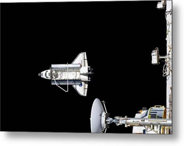 Discovery Departing The Iss Metal Print by Nasa/science Photo Library