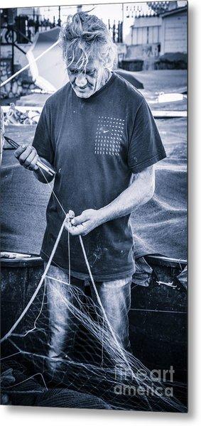 fisherman mending nets on Anzio harbour Metal Print