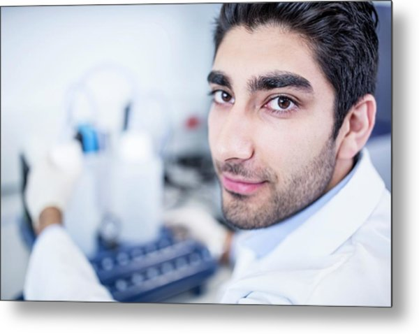 Lab Assistant Using Equipment Metal Print by Science Photo Library