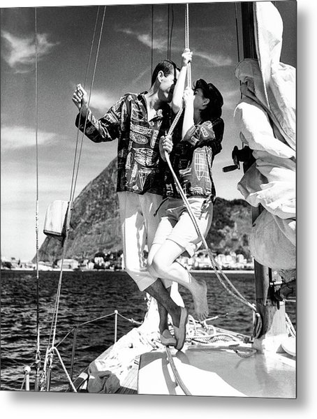 Models Wearing A Bennett Shirts On A Sailboat Metal Print by Richard Waite