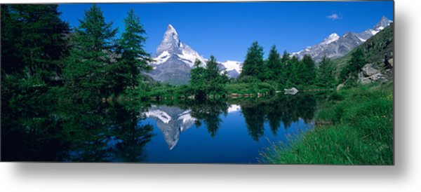 Reflection Of A Snow Covered Mountain Metal Print