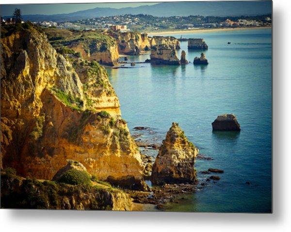 Metal Print featuring the photograph Rocky Coast And Sea At Background by Raimond Klavins