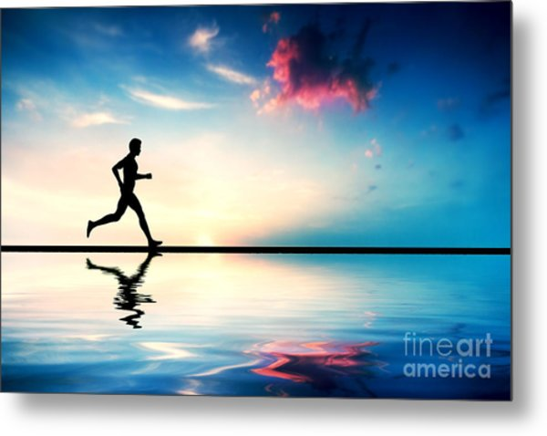 Silhouette Of Man Running At Sunset Metal Print
