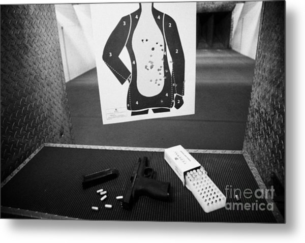 Smith And Wesson 9mm Handgun With Ammunition At A Gun Range Metal Print by Joe Fox