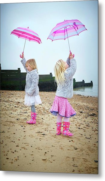 Two Girls On Beach Holding Umbrellas Metal Print by Ruth Jenkinson