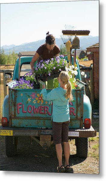 Two Young Women Load Their Landscaping Metal Print