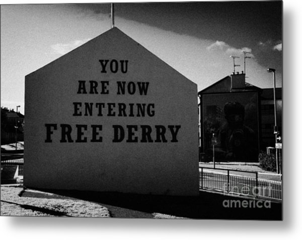you are now entering free derry gable wall painting with petrol bomber mural in the background at free derry corner in the bogside area of Derry Londonderry Metal Print