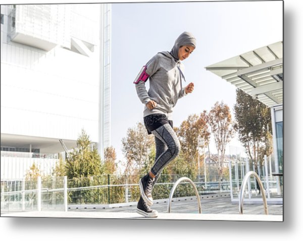 Young Muslim Woman Ready To Running In The City Metal Print by LeoPatrizi