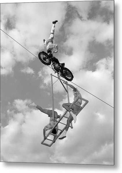 1950s 1960s High-wire Act With Man Metal Print