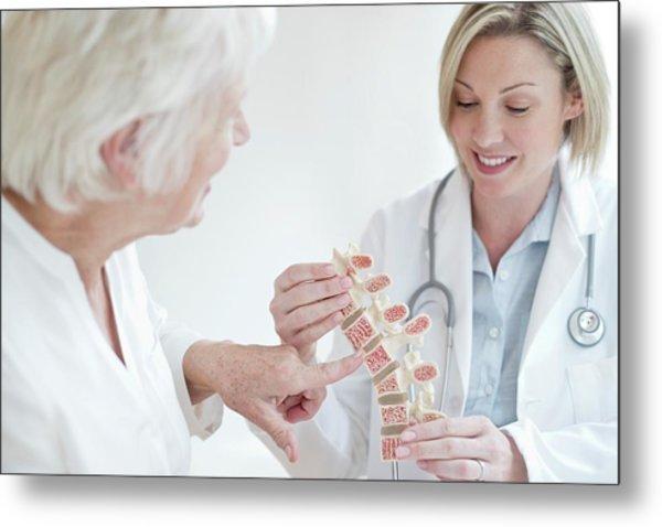 Female Doctor Holding Anatomical Model Metal Print