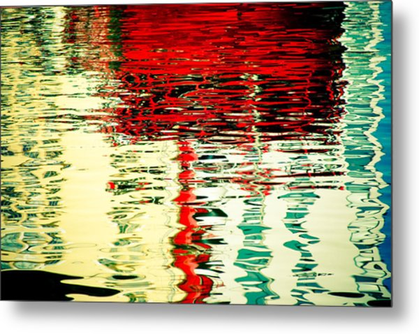 Reflection In Water Of Red Boat Metal Print
