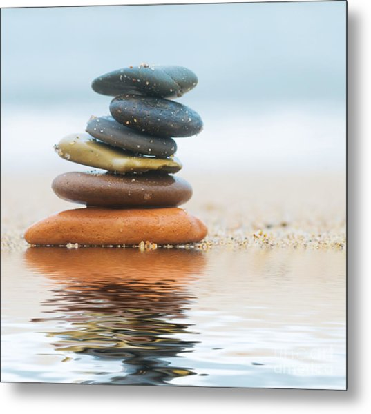 Stack Of Beach Stones On Sand Metal Print