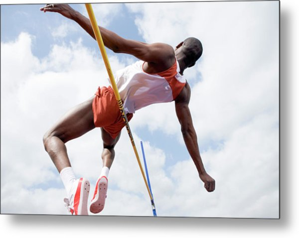 Athlete Performing A High Jump Metal Print by Gustoimages/science Photo Library