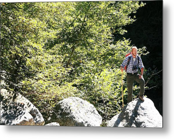 Man Hiking In The Sun Metal Print by Mauro Fermariello/science Photo Library