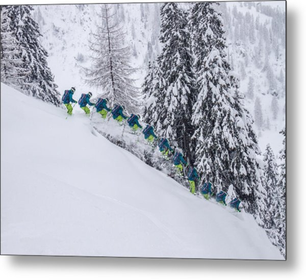 Young Male Freerider Skiing Down A Powder Slope Metal Print by Leander Nardin