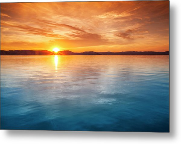 Sunset Over Water Metal Print by Focusstock