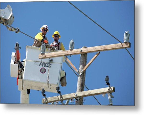 Repairing Power Lines Metal Print
