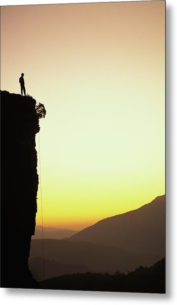 A Climber Stands Atop A Cliff Metal Print