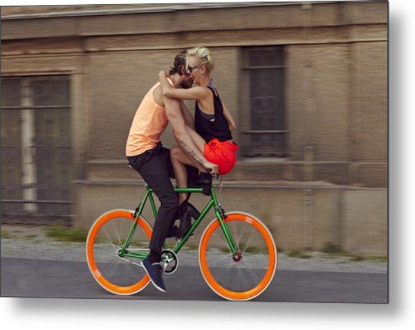 A Couple Biking Through The City Metal Print by Justin Case