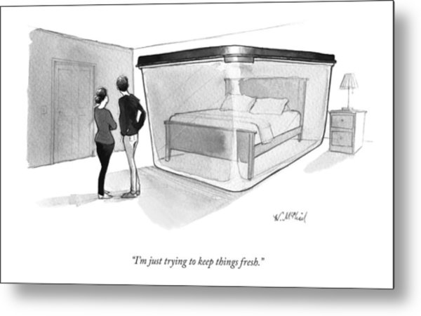 A Couple Looks At A Bed Encased In A Giant Metal Print