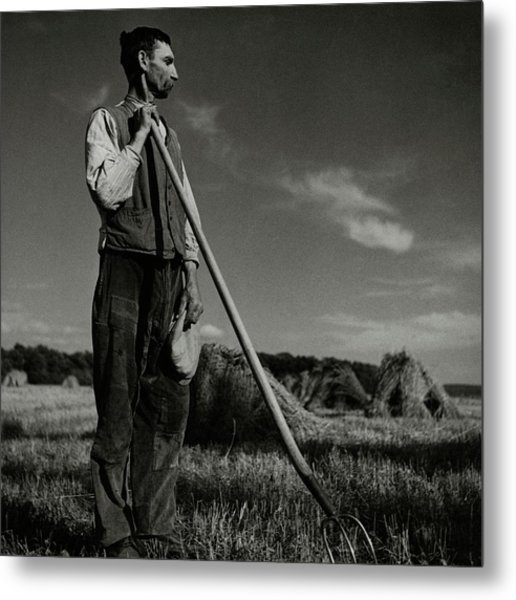 A Farmer Holding A Pitchfork Metal Print by Roger Schall