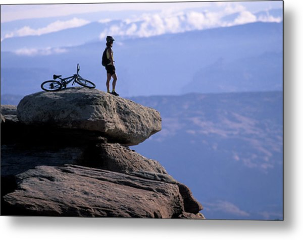 A Female Mountain Biker Stands Metal Print