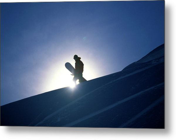 A Female Snowboarder Hiking Metal Print