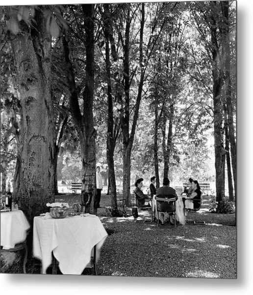 A Group Of People Eating Lunch Under Trees Metal Print