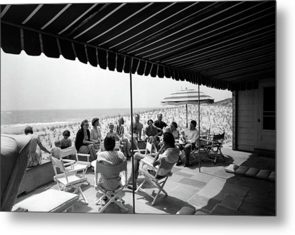A Group Of People On A Terrace Overlooking Metal Print