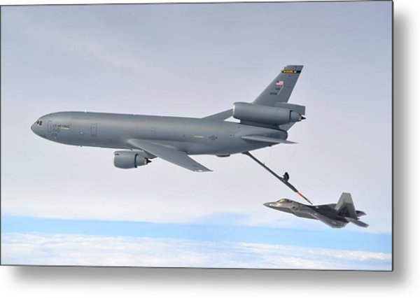 A Kc-10 Extender Refuels An F-22 Raptor Metal Print