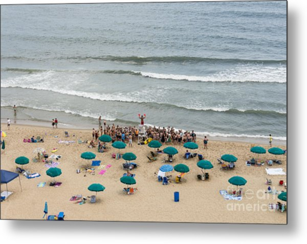 A Lifeguard Gives A Safety Briefing To Beachgoers In Ocean City Maryland Metal Print