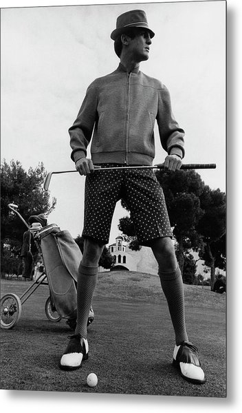 A Male Model Posing As A Golfer Wearing Metal Print