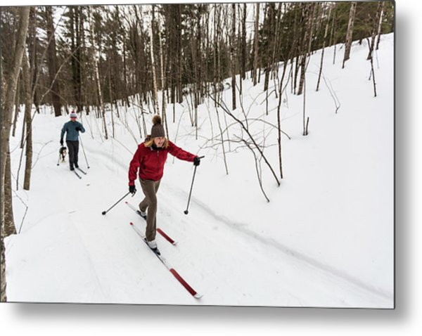 A Man And Woman Cross Country Skiing Metal Print