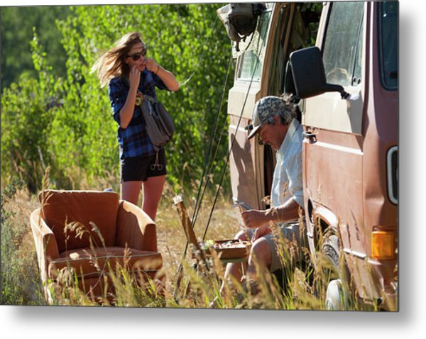 A Man And Woman Preparing To Fly Fish Metal Print