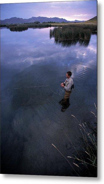 A Man Fishing At Dusk In A River Metal Print
